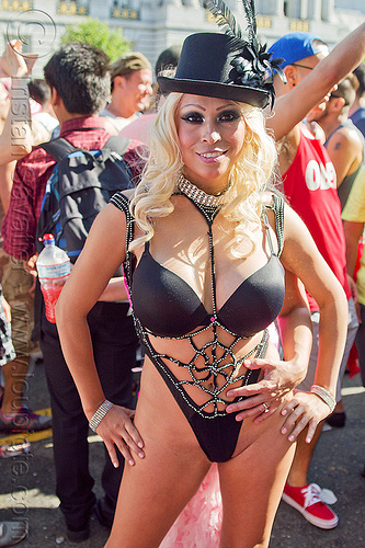 woman in scanty black party attire - bowler hat, black bra, black feathers, black hat, bowler hat, collar, eye makeup, gay pride festival, party fashion, woman
