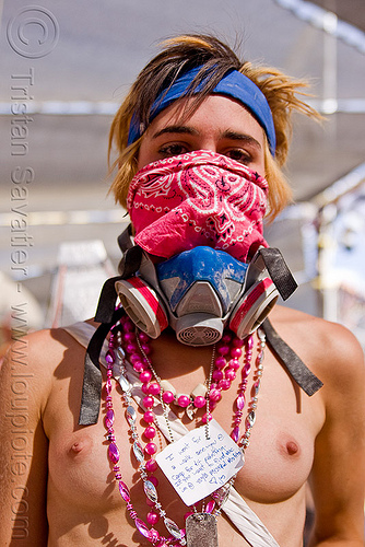 woman with bandanna and dust mask, breasts, burning man, center camp, dog tag, dust mask, headband, melissa, msa respirator, necklaces, pink bandana, topless woman