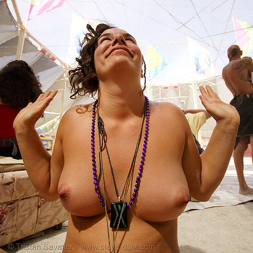 DSC01925 - burning man 2007 - woman with beads and necklaces - corine, breasts, burning man, center camp, corine, topless woman