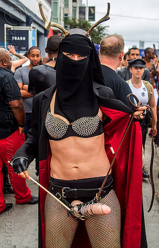 woman with burqa and strap-on dildo, bondage, burka, burqa, chador, chadri, deer horns, dildo harness, fake horns, fetish, headgear, hijab, islam, islamic, muslim, sex toy, strap on, veil, woman