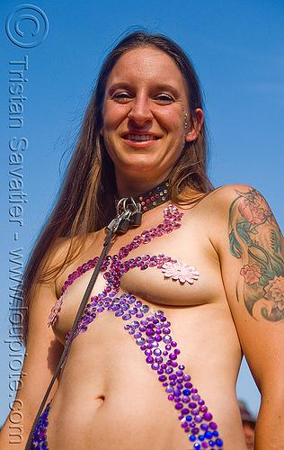 woman with purple bindis - folsom street fair 2009 (san francisco), arm tattoo, bindis, flower tattoo, folsom street fair, pasties, purple, tattooed, topless woman