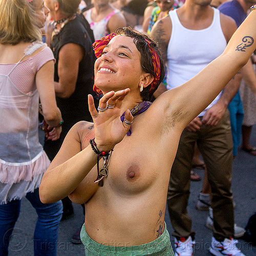 yassmine dancing at decompression 2014 (san francisco), arm tattoo, bandana, bracelets, burning man decompression, dancing, headband, hippie, jewelry, necklaces, rings, topless woman, yassmine