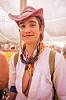 monkey chant master of ceremony - burning man 2015, burning man, center camp, gamelan x, monkey chant, open shirt, pink hat, woman