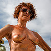 glittery girl - burning man 2008, body art, body paint, body painting, breasts, burning man, glittery, sunglasses, topless woman