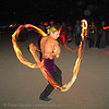 fire dancer - spinning poi - decon - burning-man 2005, art, burning man, fire dancer, fire dancing, fire performer, fire spinning, flames, long exposure, night, refraction, shaina, spinning fire, topless woman
