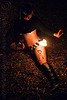 woman with tattoo - fire doohickey, fire dancer, fire dancing, fire doohickey, fire performer, fire spinning, fire wicks, flames, haley, leg tattoo, night, tattooed, tattoos, woman